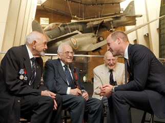 Britain's Prince William meets Freddie Knoller and two other veterans of World War II, Ted Cordery and John Harrison, during a visit to the Imperial War Museum in London.