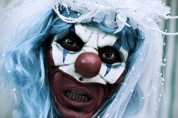 scary evil clown in a bride dress