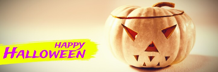 Composite image of digital image of happy halloween text