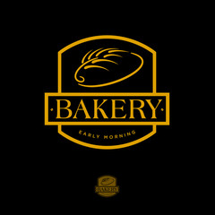 Bakery logo. Pastry logo. Bread and spike on dark background