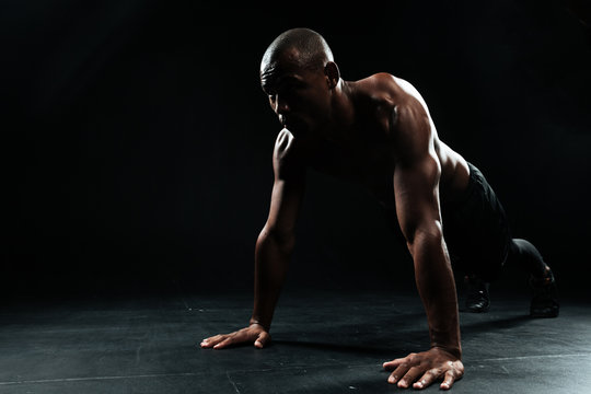 Portrait of youg afro american sports man doing pushup exercise
