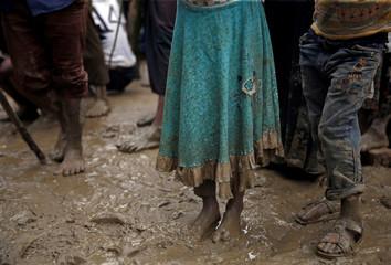 Rohingya refugee children queue for aid in Cox's Bazar, Bangladesh
