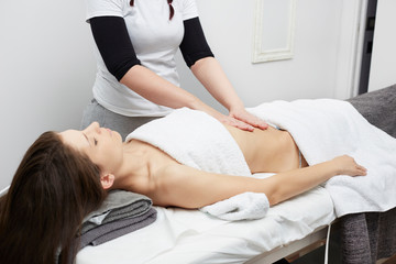 Female Enjoying Relaxing Belly Massage In Cosmetology Spa Center