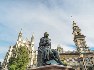 Robert Burns statue, Dunedin Town Hall and St. Paul's Cathedral. (Dunedin, New Zealand)