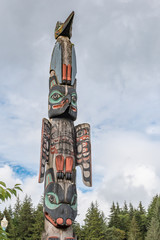 Totem pole with raven and eagle and bear