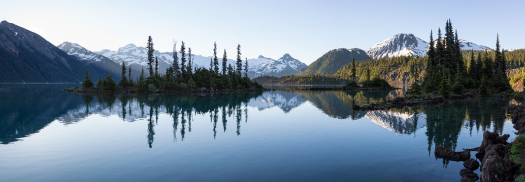 Beautiful morning view on a famous hiking spot, Garibaldi Lake, during a vibrant summer sunrise. Located near Squamish and Whistler, North of Vancouver, BC, Canada.