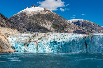 Wide angle view of an Alaskan glacier with blue ice