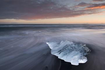 Stranded ice block. Jökulsarlon glacier bay, Iceland