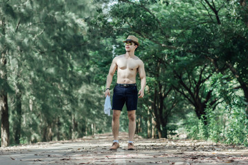 Young man tourists standing on floor in forest,relax body,travel style in the forest.