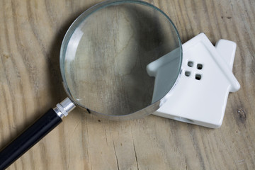 House and Key With Magnifying Glass