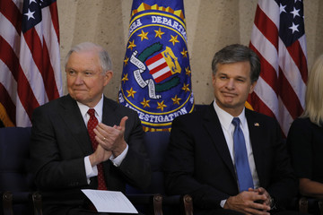 U.S. Attorney General Sessions applauds prior to  installation ceremony for FBI Director Wray in Washington