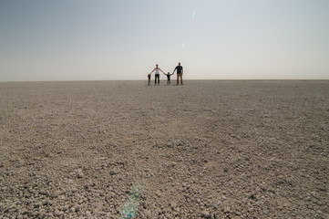 A family of four provides perspective to the massive size of the Etosha Pan