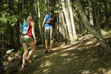 Couple hiking through the forest