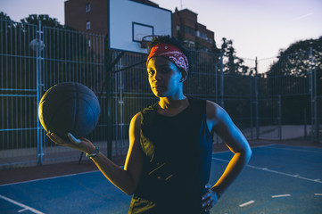 Latin woman poses with basket ball