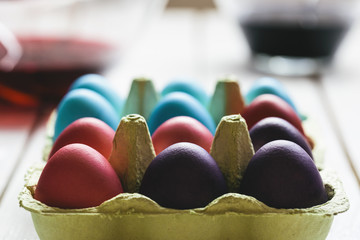 Colored easter eggs in carton