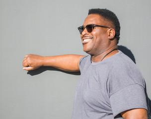 smiling middle aged black man knocking on door