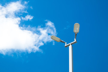 Solar cells LED light in blue sky with clouds. Fotomurales