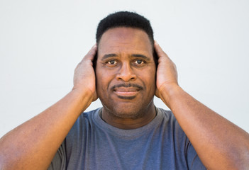 close up of black man with hands covering ears-hear no evil