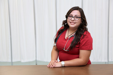 Portrait of a young Hispanic Female Healthcare Professional,  Woman Nurse