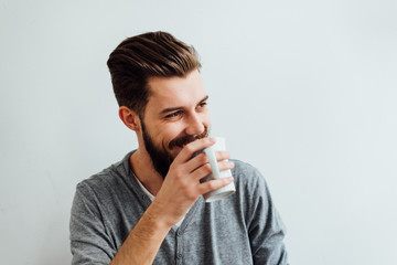 Handsome Bearded Man Having a Cup of Coffee