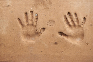 Handprint on cement wall