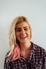 Portrait of a Smiling Blond Woman With Pink Highlight
