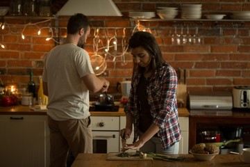 Young couple making food at home