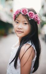 Beautiful little girl portrait with pink rose headband