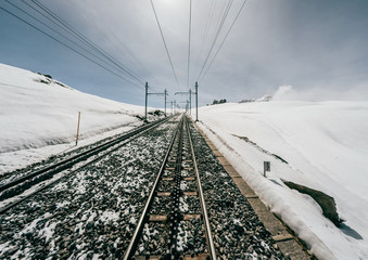Driver view of train crossing snow mountain