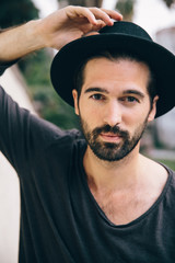 Portrait of a Hip Young Bearded Man in a Hat