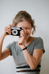 Young woman holding film camera