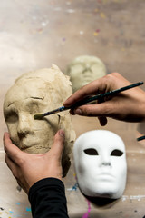 Man making a venetian mask