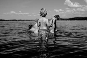 Four children in water in Finland.