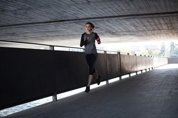 Woman jogging in basement