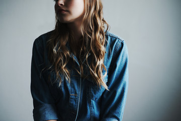 Cropped image of a young woman wearing denim