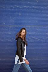Girl walking next to blue garage doors
