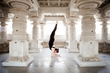 Woman doing yoga at a temple in India