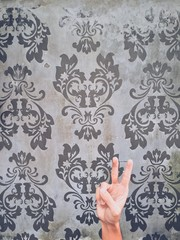 Wallpaper with peace sign with hand