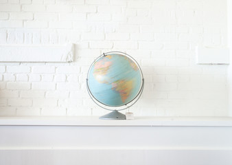 Globe isolated against white wall