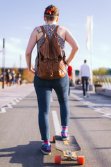 Young woman driving a longboard