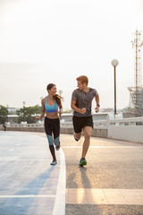 Couple running together outdoors