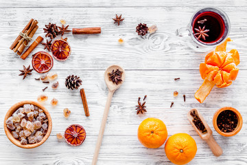 Merry christmas in winter evening with warm drink. Hot mulled wine or grog with fruits and spices on light background top view