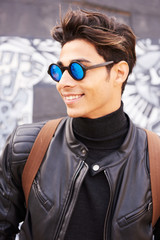 Close-up of trendy man in mirrored sunglasses