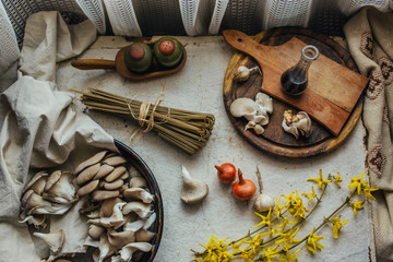 Different food ingredients on white rustic table