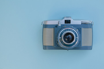 Blue vintage camera on a blue background
