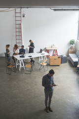 Young business people meeting in a modern workspace