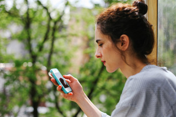 Young woman browsing on her smart phone