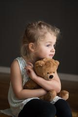 girl and teddy bear