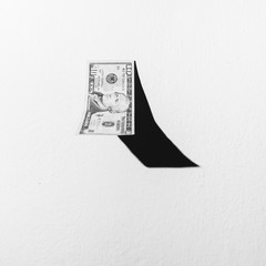 10 dollar bill falling against a white background