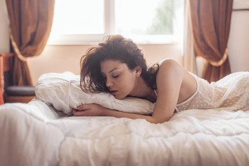Portrait of sensual woman lay on bed